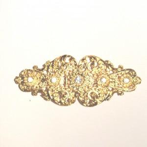 Broche dorado con pedreria